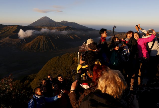 People take pictures of Bromo Tengger Semeru National Park during sunrise on top of Mount Pananjakan, ahead of Kasada festival in Indonesia's East Java province, July 31, 2015. (Photo by Reuters/Beawiharta)
