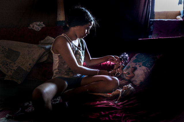 A girl plays with her dolls. In 2011 there were plans to turn the IBGE building into a cultural centre, but so far no work has been done. (Photo by Tariq Zaidi/The Guardian)