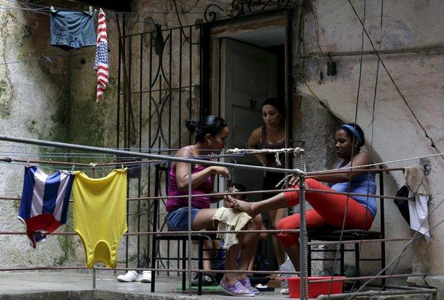 Women talk in their house in Havana April 11, 2015. (Photo by Enrique De La Osa/Reuters)