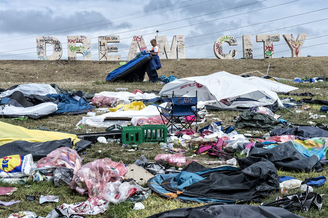 Lots of tents, sleeping bags, air mattresses and waste are left in the camping area of the Roskilde festival, in Roskilde, Denmark, July 7, 2014. The music festival ended on July 6. (Photo by Jens Noergaard Larsen/EPA)