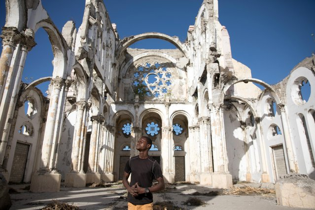 Paul Christandro poses for a picture inside of Notre Dame de l'Assomption Cathedral (Our Lady of the Assumption), destroyed in the 2010 earthquake, in Port-au-Prince, Haiti on January 10, 2020. Every morning as the sun rises over the dusty, overgrown ruins of the Haitian capital's iconic cathedral, Paul Christandro, who lived nearby all his life, thinks about the day ten years ago when he watched it come down, killing his friends. (Photo by Valerie Baeriswyl/Reuters)