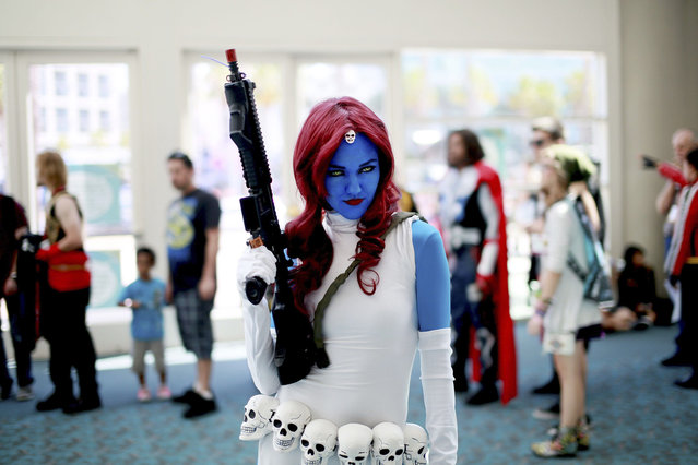 Allie Shaughnessy, who is dressed as Mystique, poses during the 2014 Comic-Con International Convention in San Diego, California July 24, 2014. (Photo by Sandy Huffaker/Reuters)