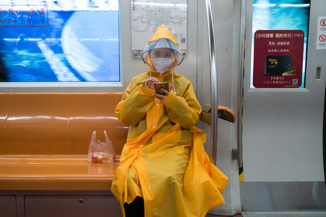 A woman wearing protective gear sits on the subway on February 10, 2020 in Beijing, China. February 10 marks the end of the Chinese New Year holidays, that were extended due to the outbreak of novel coronavirus, however, the Chinese capital remains empty and business does not seem to resume. (Photo by Andrea Verdelli/Getty Images)