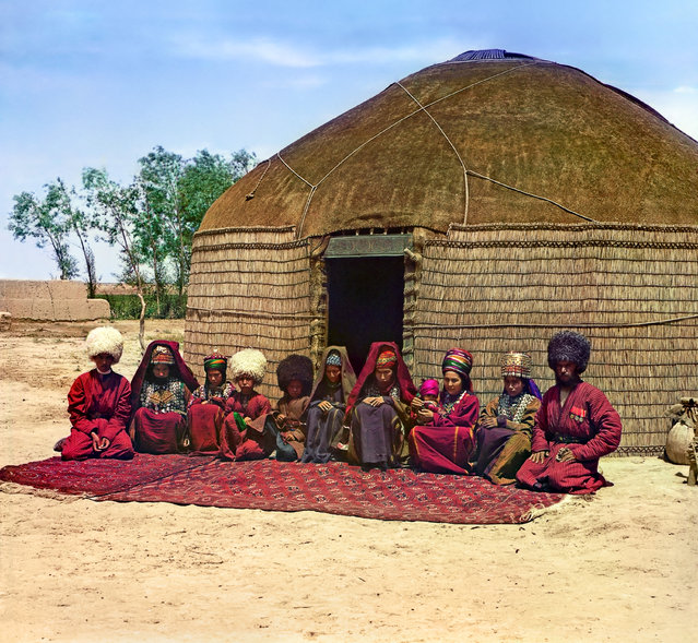 Photos by Sergey Prokudin-Gorsky. Tekin with his family (group of eleven adults and children, seated on a rug, in front of a yurt). Russia, Transcaspian Region, Merv uyezd (district), Bairam-Ali area, 1911