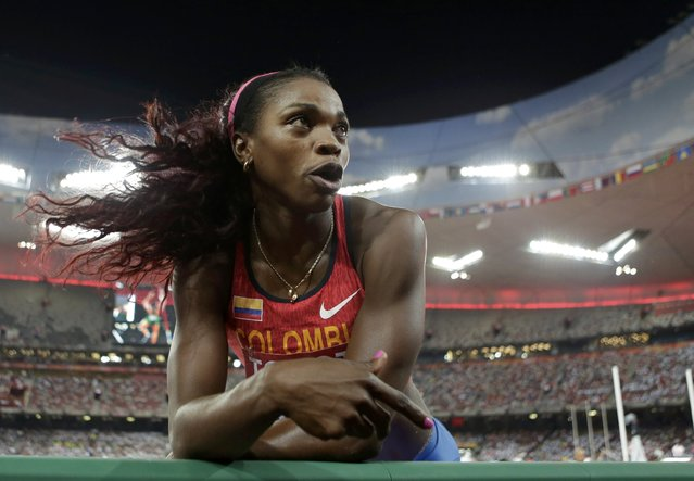 Caterine Ibarguen of Colombia speaks to her coach as she competes in the women's triple jump final during the 15th IAAF World Championships at the National Stadium in Beijing, China, August 24, 2015. (Photo by Jason Lee/Reuters)