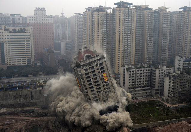 The 22-storey Yixin Mansion collapses after demolition by explosives as part of a urbanization project in Chongqing, China, January 14, 2015. (Photo by Reuters/China Daily)