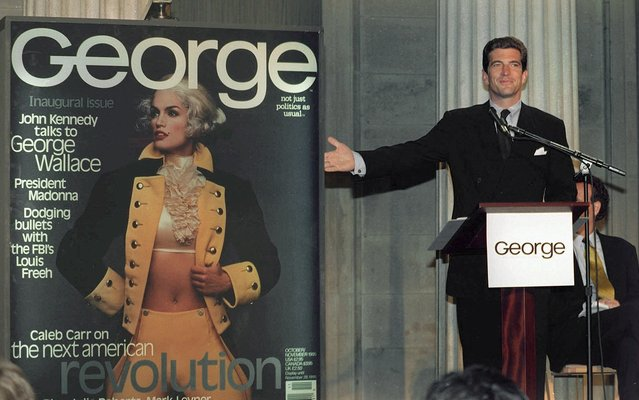 In this September 7, 1995 file photo, John F. Kennedy Jr., co-founder and editor-in-chief of the politics-as-lifestyle George magazine, unveils the magazine's first cover in New York. A documentary film on John Kennedy Jr.'s life opens Friday, July 22, 2016, in select theaters. It also airs on Spike TV at 9 p.m. EDT on Aug. 1, and a DVD release is set for Aug. 16. (Photo by Marty Lederhandler/AP Photo)