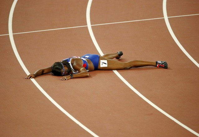 Tiffany Porter of Britain lies on the track after competing in the women's 100 metres hurdles final during the 15th IAAF World Championships at the National Stadium in Beijing, China August 28, 2015. (Photo by David Gray/Reuters)