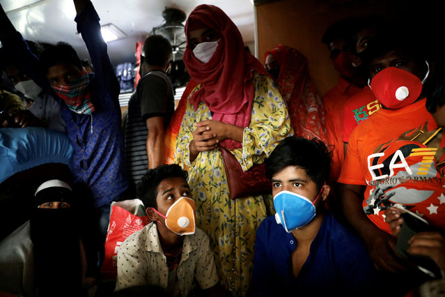 People board an overcrowded train at the Kamalapur Railway Station, before the shutdown of all the public transports amid coronavirus disease (COVID-19) outbreak in Dhaka, Bangladesh, March 24, 2020. (Photo by Mohammad Ponir Hossain/Reuters)