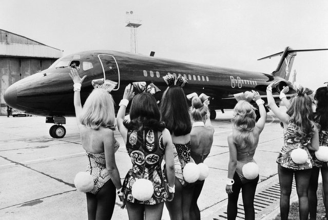 """Photo taken on August 30, 1970 shows playmates or bunnies of Playboy Magazine arriving at London airport with the Playboy jet """"Big Bunny"""". (Photo by AFP Photo/Stringer)"""