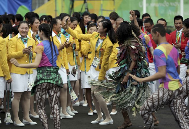 Chinese athletes take pictures as they arrive at the Olympic Village in Rio de Janeiro, Brazil on August 3, 2016. (Photo by Alkis Konstantinidis/Reuters)