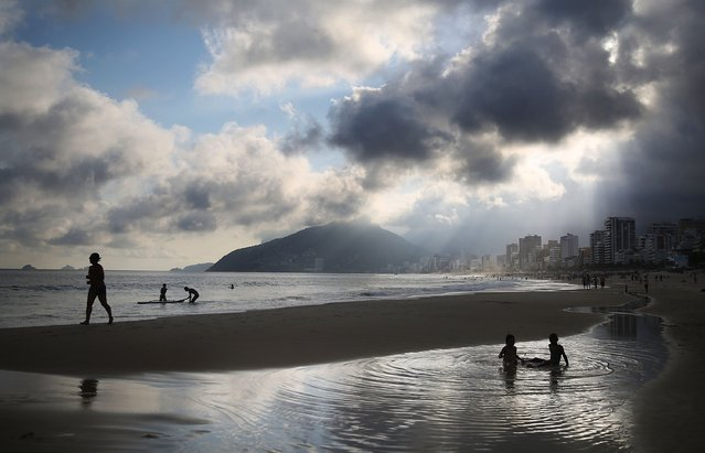 People gather and play on Ipanema beach on September 2, 2014 in Rio de Janeiro, Brazil. Brazil's general elections will be held October 5. (Photo by Mario Tama/Getty Images)