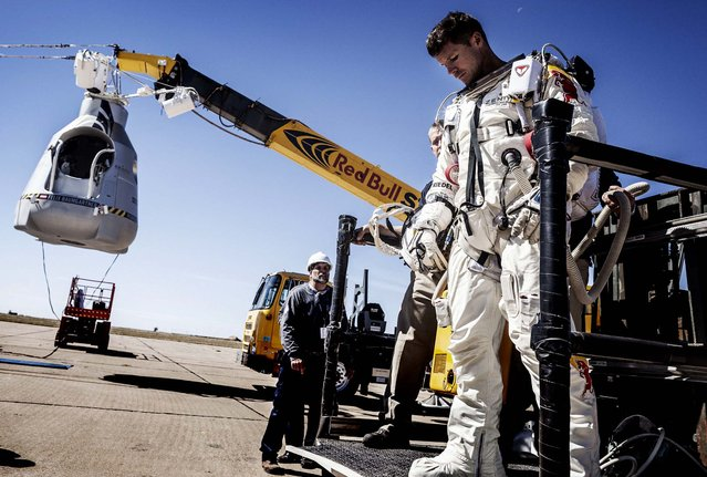 Baumgartner leaves the capsule after his mission was aborted. (Photo by Balazs Gardi/Red Bull Stratos)
