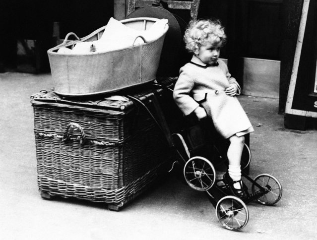 Typical scene at Waterloo Station as a youngster guards luggage and baby while waiting for train to evacuate to the country, in London  August 25, 1939. (Photo by AP Photo)