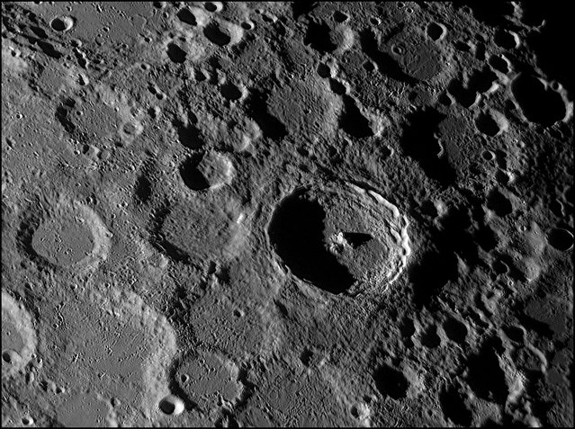 """Bets of the Craters"". The crater Tycho although not the largest on the Moon, can still be seen easily on the Moon's surface, boasting a diameter of 86km. Formed by meteroic impacts over billions of years, these bowl-shaped lunar features are typically named after scientists, artists and explorers. The central peak of the large crater featured here, was the most likelyformed when the rocks of the crater floor rebounded immediately after it was formed. Runner up in the Our Solar System category. (Photo by George Tarsoudis, Greece/The Astronomy Photographer of the Year 2014 Contest)"