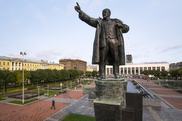 In this photo taken on Tuesday, October 17, 2017, a famous statue of Vladimir Lenin stands in front of the Finlyandsky (Finnish) railway station in St. Petersburg, Russia. The station is most famous for having been the location where Vladimir Lenin returned to Russia from exile in Switzerland in April 16, 1917, ahead of the October Revolution. (Photo by Dmitri Lovetsky/AP Photo)