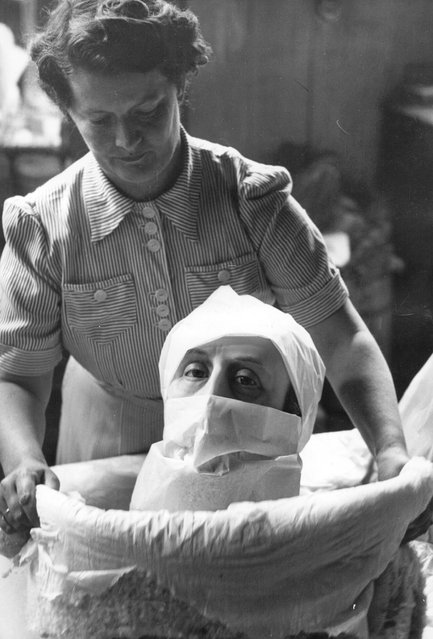 A wax head being packed up for despatch at a factory which specialises in near-life models for shop windows, museums and exhibitions, 1950. (Photo by John Chillingworth)
