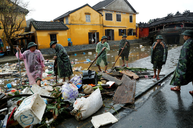 Vietnam soldiers clean debris caused by flooding by Typhoon Damrey in the ancient UNESCO heritage town of Hoi An, Vietnam November 8, 2017. (Photo by Jorge Silva/Reuters)