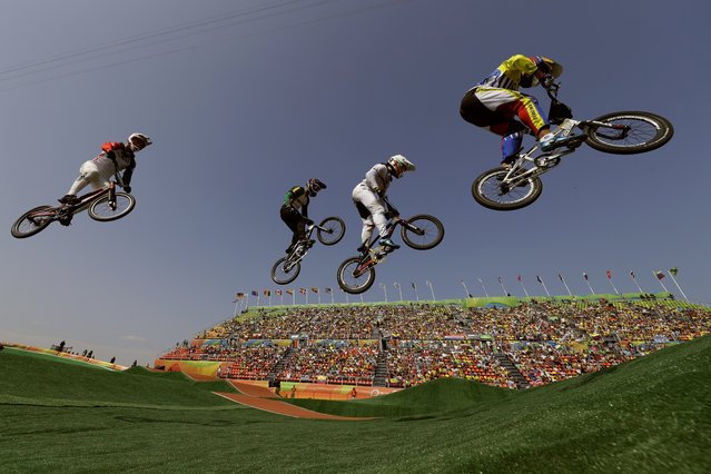 Cyclists, from right, Jefferson Milano of Venezuela, Luis Brethauer of Germany, Kyle Dodd of South Africa and David Graf of Switzerland compete in the BMX cycling quarterfinals during the 2016 Summer Olympics in Rio de Janeiro, Brazil, Thursday, August 18, 2016. (Photo by John Locher/AP Photo)