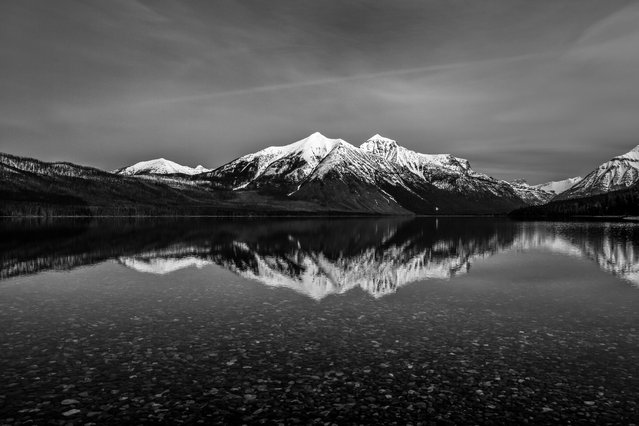 """Simplistic"". It was a very calm day and we couldn't access much of the park due to snow. So I made the best of what I was offered. Such a beautiful place! Photo location: Lake McDonald Glacier National Park, MT. (Photo and caption by Erik Kuhlmann/National Geographic Photo Contest)"