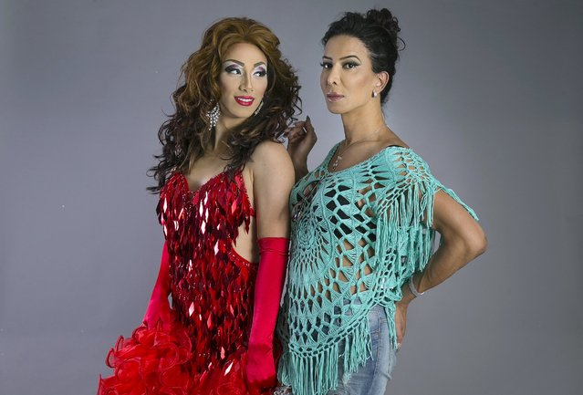 Drag queen Lior Israelov (L), who goes by the stage name Suzi Boum, and his transgender sister Arizona pose for a photo in a studio In Tel Aviv June 3, 2015. While Tel Aviv has become a world-class destination for gay tourism, the holy city of Jerusalem was the scene of an attack by an ultra-Orthodox Jew that killed an Israeli teenager at an annual Gay Pride parade on July 30. The assailant, who called the parade an abomination against God, has been charged with murder. (Photo by Baz Ratner/Reuters)