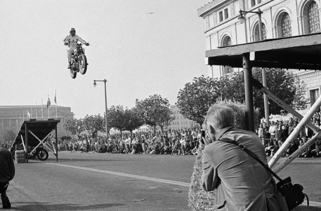Exhibition Motorcycle Rider Evel Knievel, former movie stunt man, jumps his cycle between two ramps, a hundred feet apart, to open a Sports Cycle Exhibition at the Civic Center, November 23, 1967, San Francisco, Calif. Knievel is planning to jump the Grand Canyon with a jet engine on his cycle, wings and a parachute some time the next year. (Photo by AP Photo)
