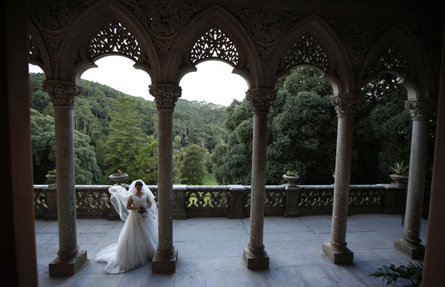 A woman wearing a wedding dress is photographed at Monserrate Palace in Sintra October 7, 2014. Sintra became the first centre of European Romantic architecture in the 19th century, which influenced the development of landscape architecture throughout Europe. It was classified as a World Heritage Site by UNESCO in 1995. Its monuments are visited by more than 1.5 million of tourists every year, according to local media. (Photo by Rafael Marchante/Reuters)