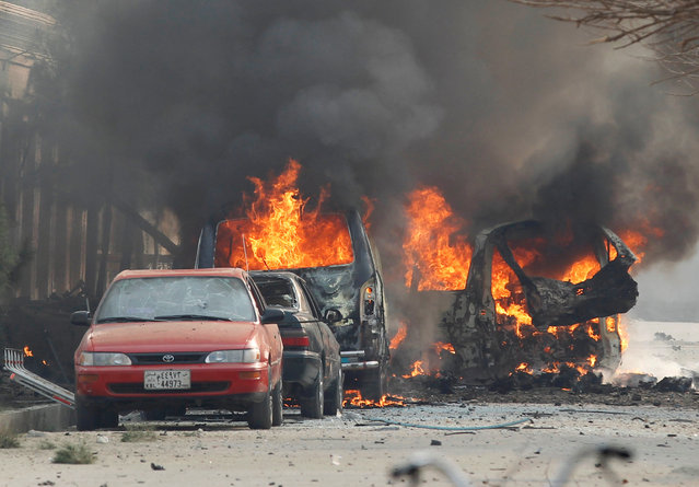 Vehicles are seen on fire after a blast in Jalalabad, Afghanistan January 24, 2018. (Photo by Reuters/Parwiz)