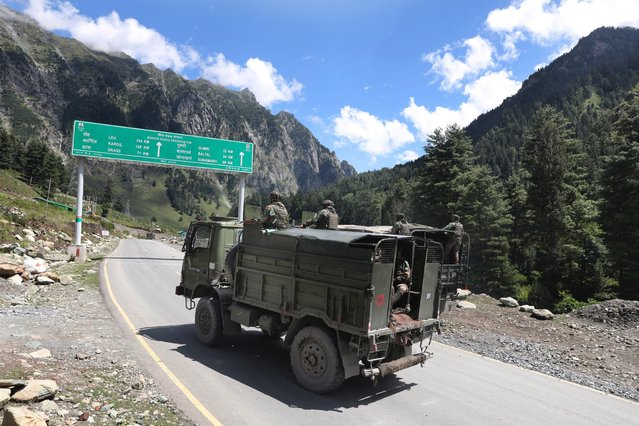 Indian army vehicles move along a highway leading to Ladakh, at Gagangeer some 81 kilometers from Srinagar, the summer capital of Indian Kashmir, 07 September 2020 (issued 10 September 2020). Apart from nomadic families with goats, sheep and horses, no one is allowed to travel along the normally bustling mountain road to allow the Indian military to operate freely amid a months-long standoff between India and China along the disputed border in eastern Ladakh. (Photo by Farooq Khan/EPA/EFE)