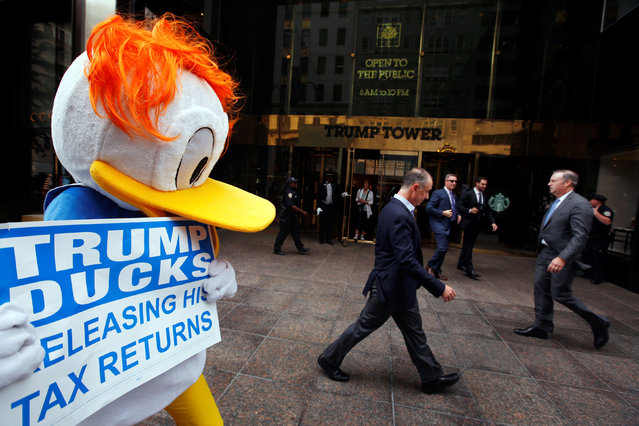 An activist by the name of DJ Quacker holds a sign asking Republican presidential nominee Donald Trump to release his tax forms, outside of Trump Tower in New York City, New York, U.S., September 6, 2016. (Photo by Lucas Jackson/Reuters)