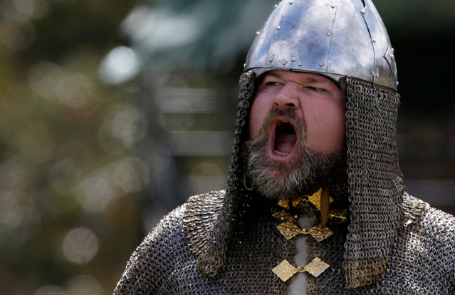A participant in medieval garb shouts victory following a mock viking battle at the St Ives Medieval Fair in Sydney, one of the largest of its kind in Australia, September 24, 2016. (Photo by Jason Reed/Reuters)