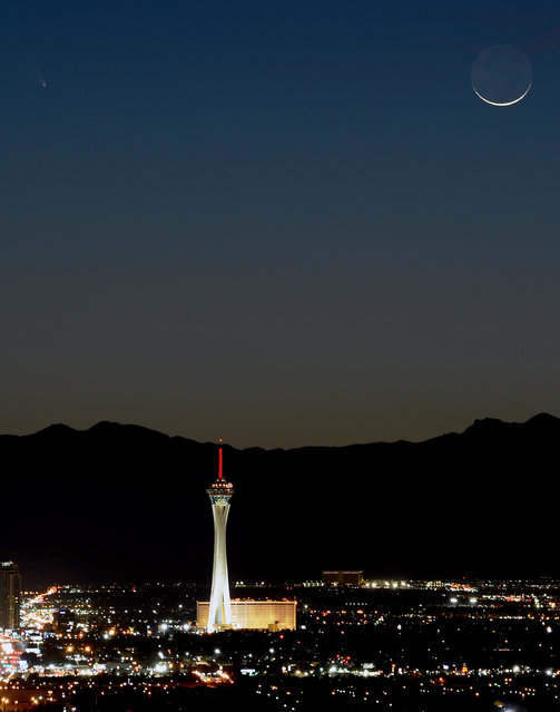 The comet PanSTARRS, above and to the left, passes over the Stratosphere Casino Hotel along with a waxing crescent moon at twilight over the Spring Mountains range on March 12, 2013 in Las Vegas, Nevada. Officially known as C/2011 L4, the comet got its name after being discovered by astronomers using the Panoramic Survey Telescope & Rapid Response System (Pan-STARRS) telescope in Hawaii in June 2011.  (Photo by Ethan Miller)