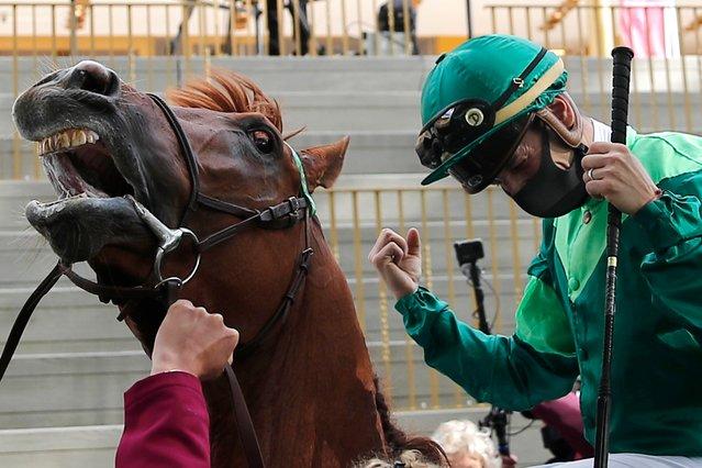 Jockey Cristian Demuro riding Sottsass celebrates after winning the Qatar Arc de Triomphe horse race at the Longchamp race track, outside Paris, Sunday October 4, 2020. (Photo by Francois Mori/AP Photo)
