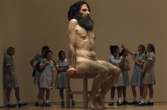 "A group of schoolgirls look at a sculpture entitled ""Wild man"" by Australian sculptor Ron Mueck at the National Gallery of Victoria in Melbourne, February 10, 2010. (Photo by Mick Tsikas/Reuters)"