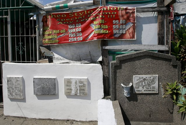 An advertising banner for a salon is placed on a makeshift house inside the Manila South Public Cemetery in Pasay City, metro Manila October 30, 2015. (Photo by Romeo Ranoco/Reuters)
