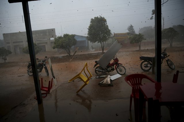 Rio Pardo, next to Bom Futuro National Forest, during a tropical storm in the district of Porto Velho, Rondonia State, Brazil, August 30, 2015. (Photo by Nacho Doce/Reuters)