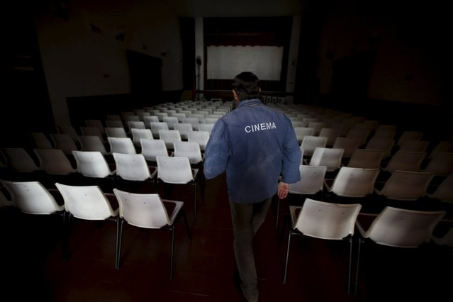 Projectionist Antonio Feliciano, 75, arrives to check a theatre before a projection in Monforte, Portugal May 16, 2015. (Photo by Rafael Marchante/Reuters)