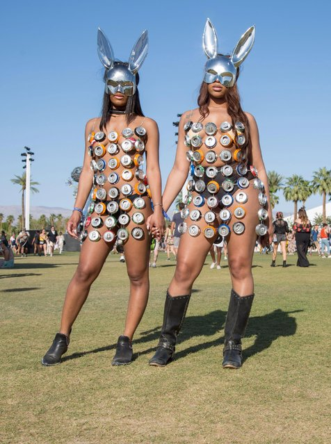 Chanel Twyman (L), 23, and Auzuanay Watkins, 25, both of Philadelphia, Pennsylvania pose at the Coachella Music and Arts Festival in Indio, California, April 14, 2018. Coachella became one of the world' s premier music festivals not only for the A- list performers. The two- weekend party in the California desert has become a major event in its own right for the fashion. While designers have heavily marketed their brands to Coachella, the fans who draw the most notice often do so by embracing their own sartorial flair, driven by a sense of innovation and, among revelers in the searing heat, of inhibition. (Photo by Kyle Grillot/AFP Photo)