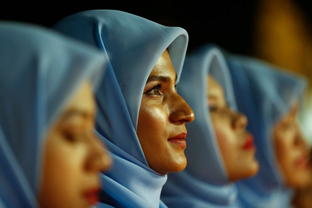 Muslim girls take part the Interreligious Gathering of Prayer for Peace ceremony in Yangon, Myanmar, 31 October 2017. Aung San Suu Kyi's National League for Democracy (NLD) party staged a demonstration of Interreligious Gathering of Prayer for Peace ceremony. (Photo by Lynn Bo Bo/EPA/EFE)