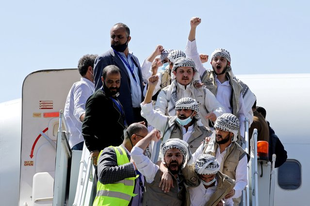 Freed Houthi prisoners arrive after their release in a prisoner swap, in Sanaa airport, Yemen on October 15, 2020. (Photo by Khaled Abdullah/Reuters)