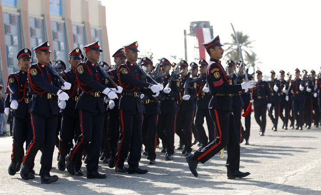 Soldiers march as they participate in their graduation ceremony during Iraqi Army Day anniversary celebration in Baghdad January 6, 2015. (Photo by Thaier al-Sudani/Reuters)