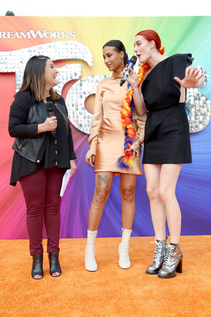 """Red Carpet Emcee Sisanie Villa Clara and Icona Pop seen at DreamWorks Animation and Twentieth Century Fox Present the Los Angeles Premiere of """"Trolls"""" at Regency Village Theatre on Sunday, October 23, 2016, in Los Angeles. (Photo by Blair Raughley/Invision for Twentieth Century Fox/AP Images)"""