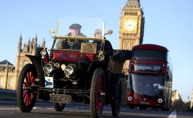 Participants drive their 1904 Wolseley car during the annual London to Brighton veteran car run in London, Britain November 6, 2016. (Photo by Neil Hall/Reuters)