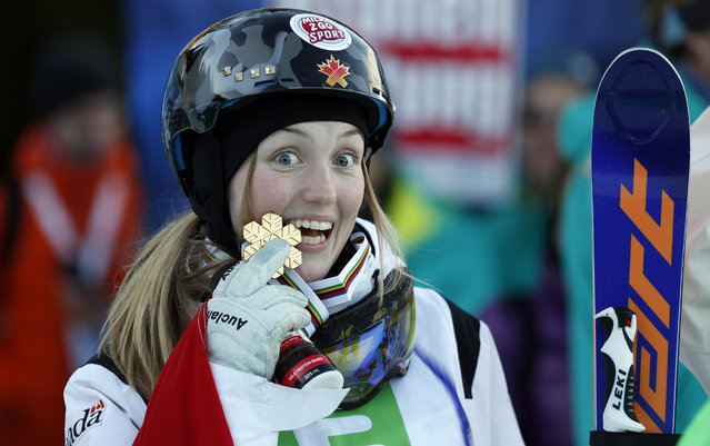 Canada's Justine Dofour-Lapionte celebrates her victory in the women's  freestyle skiing single moguls final event at the Freestyle Ski and Snowboard World Championships in Kreischberg, Austria, Sunday, January 18, 2015. (Photo by Darko Bandic/AP Photo)