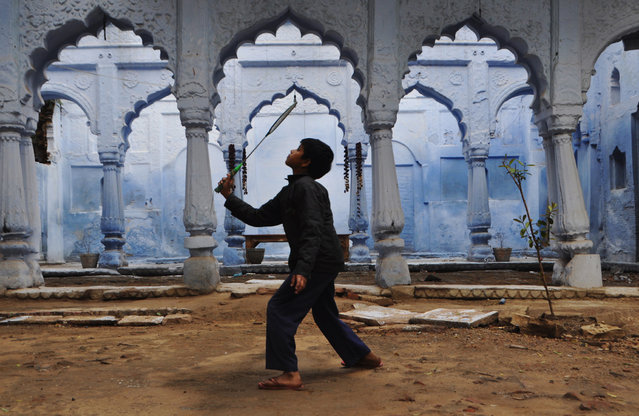 """""""Child's game"""". The photo is taken in the backyard of an old house in Allahabad, India, on February 2013. (Photo and caption by Nana Kantsa/National Geographic Traveler Photo Contest)"""