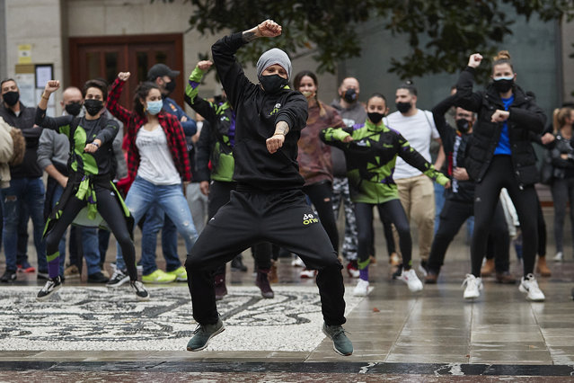A monitor performs Zumba during a protest of gyms and sport centers users and workers asking for help against the latest virus restrictions on November 14, 2020 in Granada, Spain. Gyms and sports centers are closed because they are not considered essential services. The measures imposed by the regional government allow the opening of tobacconists and not centers where health is worked, and this sectors claims that we are not the problem, we are the solution. (Photo by Fermin Rodriguez/NurPhoto via Getty Images)