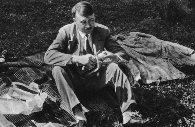 "German Nazi leader Adolf Hitler (1889 - 1945) enjoys a quiet picnic between meetings, circa 1933. Picture 196 of a series of collectable images published in Germany during the Nazi period, entitled ""Deutschland Erwacht"" (Germany Awakes). (Photo by Heinrich Hoffmann/Hulton Archive/Getty Images)"