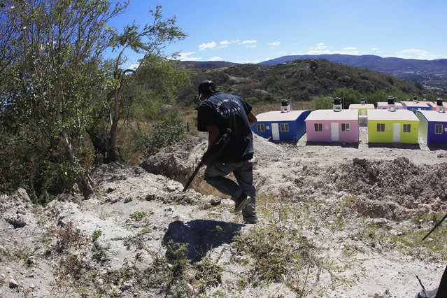 A member of the Community Police of the FUSDEG (United Front for the Security and Development of the State of Guerrero) participates in a patrol in the village of Petaquillas, on the outskirts of Chilpancingo, in the Mexican state of Guerrero, February 1, 2015. (Photo by Jorge Dan Lopez/Reuters)