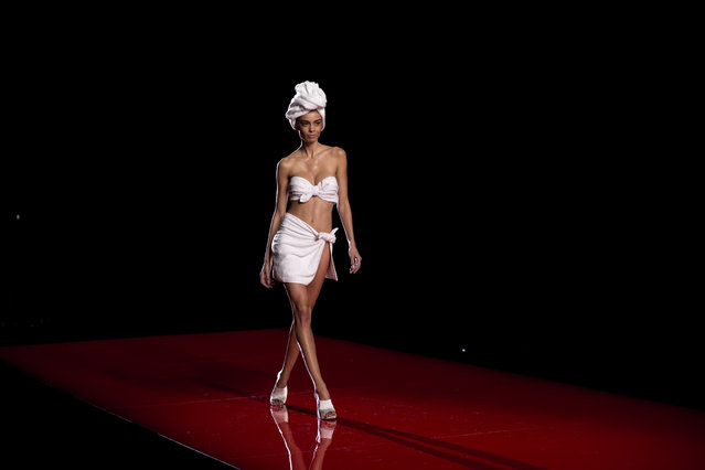 A model displays an Autumn/Winter design by Andres Sarda at Madrid's Fashion Week in Madrid, Spain, Saturday, February 7, 2015. (Photo by Daniel Ochoa de Olza/AP Photo)