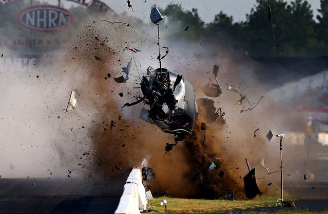 USA: NHRA pro mod driver Tim Tindle crashes during qualifying for the US Nationals at Lucas Oil Raceway in Clermont, Indiana, on September 1, 2013. Tindle walked away from the accident. (Photo by Mark J. Rebilas/USA TODAY Sports)